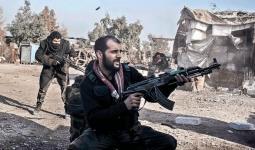 صورة أرشيفية لأحد المقاتلين في درعا