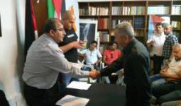 خلال عملية توزيع المنح على اللاجئين الفلسطينيين