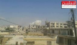 الدخان المتصاعد جراء قصف النظام السوري لمخيم درعا