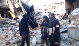 صورة أرشيفية لعناصر هيئة تحرير الشام في مخيم اليرموك