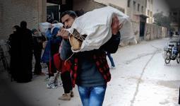 حطب ودواء من هيئة فلسطين الخيريّة لأهالي مخيّم اليرموك