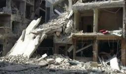 أحد المباني التي دمرها القصف في اليرموك