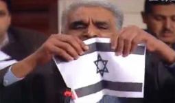 خلال تمزيق علم الكيان الصهيوني في البرلمان التونسي