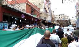 جانب من المسيرة في مخيم شاتيلا