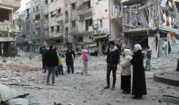 صورة أرشيفية لمنطقة الريجة في مخيم اليرموك المحاصر