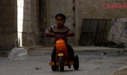 أحد اطفال مخيم اليرموك النازحين إلى جنوب دمشق