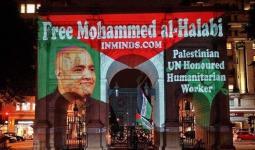 نشطاء يُضيئون جدارية في لندن تضامناً مع الأسير محمد الحلبي