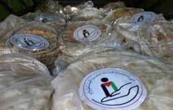الهيئة الخيرية توزع الخبز على أهالي مخيم خان الشيح