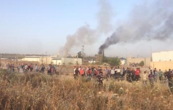 الصورة خلال حرق المركبات التابعة للمُشغلين