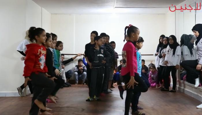 خلال تدريب أطفال فرقة الكوفية