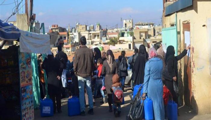 """توزيع حصص غذائية للعائلات الفلسطينية السورية في """"البداوي"""""""