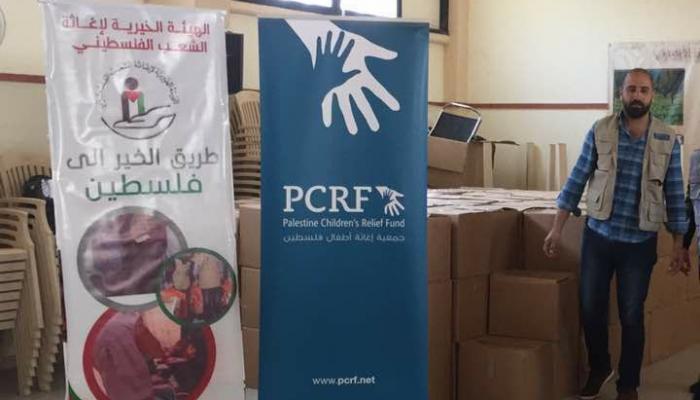 توزيع مساعدات على العائلات المتضررة منازلها في مخيّم عين الحلوة