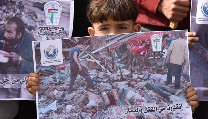 غزة- خلال الوقفة التضامنية مع أهالي مخيم خان الشيح