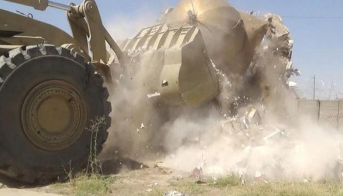 داعش تهدم القبور في مقبرة مخيم اليرموك الجديدة (صورة تعبيرية)