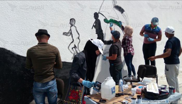 من مبادرة ارسم فلسطين على جدران المخيم